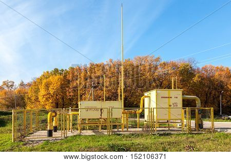 SAMARA RUSSIA - OCTOBER 9 2016: Gas regulatory and distribution point near the apartment house. Text on russian: Flammable gas