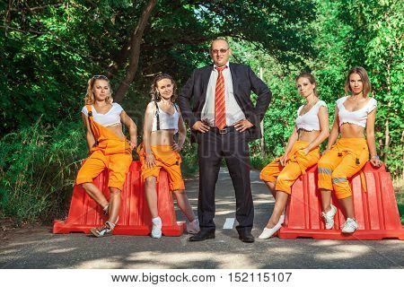 Boss and his brigade of sexy women workers.