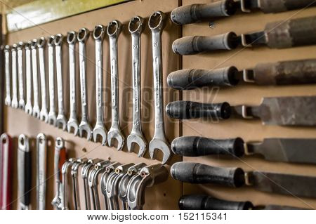 Set of wrenches. Wrenches in several different sizes hanging in the garage