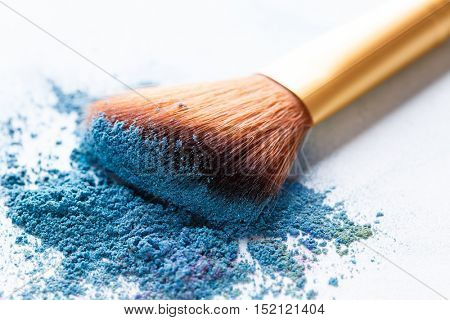 Brush lies scattered on blue shadows at white background