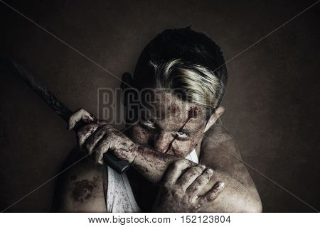 portrait of angry bloodsucker who wipe the mouth with bloody hand and knife