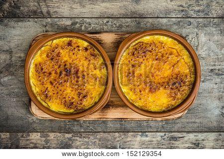 Spanish dessert. Crema catalana on wooden table