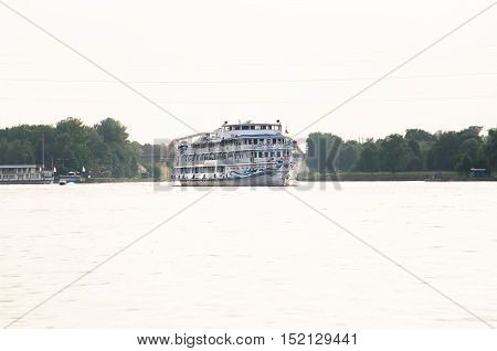 """Moscow region - JULY 15, 2016: River cruise diesel-electric ship """"Alexander Benua"""" along the river. The Klyazma reservoir in the Moscow region"""