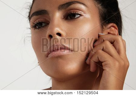 Closeup Portrait Of Spanish Woman With Ideal Skin Watching Aside