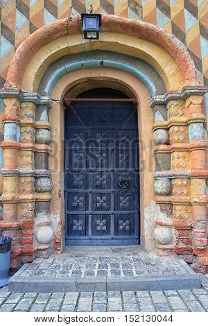 entrance porch entry beautiful; stone; portal; door; colored; decoration; frame; style; old; ancient; medieval; russian; red; material; brick; detail; good; best; image; view; photo; closeup; surface; century; architecture; building; wall; decor; paint; p