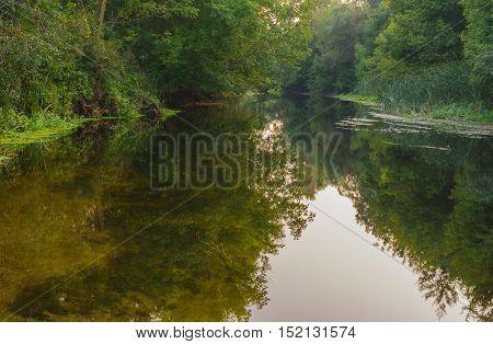 Backwater on a small Ukrainian river Vorskla at end of summer season