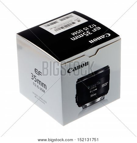 Stockholm, Sweden - March 22, 2016: A cardboard box with a Canon EF 35 mm f/2 IS USM lens isolated on white background.
