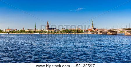 Panoramic View On The Embankment Of The Daugava River And Bridge. Riga, Latvia.