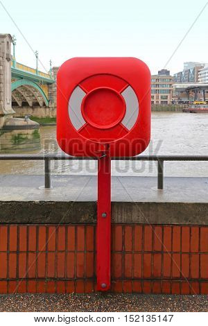 Containered Lifebuoy Life Saver by the River Thames in London