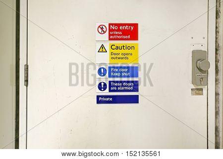 No Entry Warning Sign at Locked Door