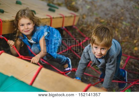 Children playing when having fun doing activities outdoors. Happy childhood concept.