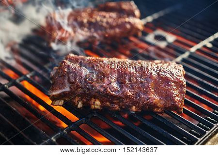 american style barbcue ribs being grilled