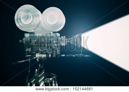 Retro movie camera with projector on abstract city background. Double exposure. Cinema concept