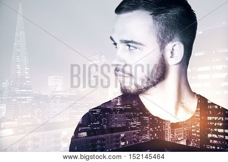 Portrait of attractive young guy on night city background with copy space. Double exposure
