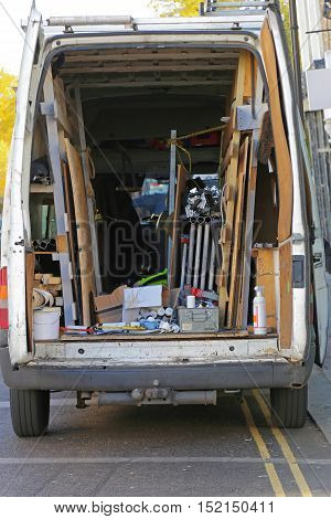 Builders Van Loaded With Construction Material and Tools