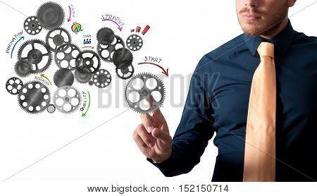 Businessman touching an analysis project with gear mechanisms designed