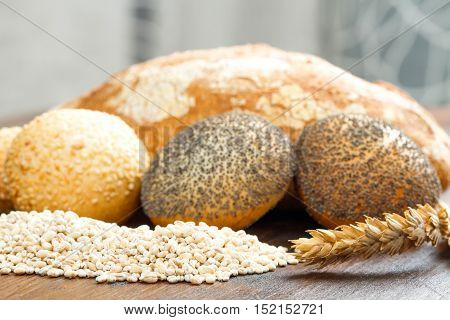 a group of healthy multi grain bread on wood