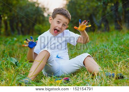 boy having fun painting with finger paint.