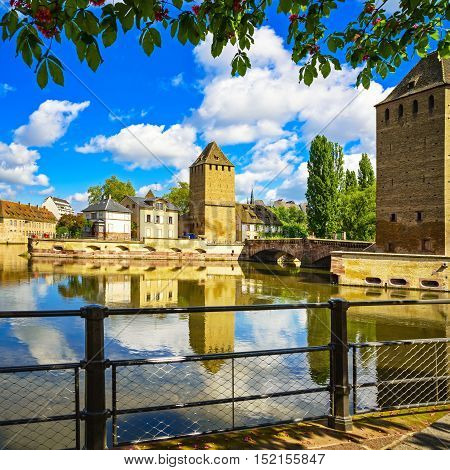 Strasbourg towers of medieval bridge Ponts Couverts and reflection Barrage Vauban. Alsace France.