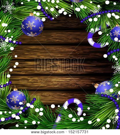 Christmas New Year design wooden background with christmas decorations candy canes snow and balls arranged in a frame in blue