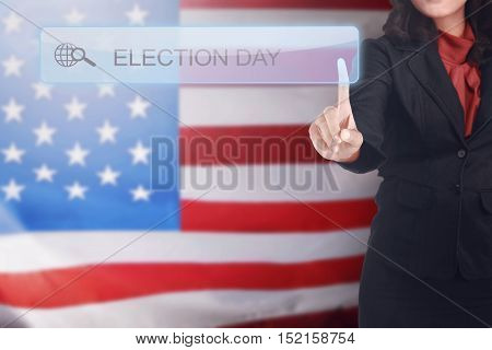 Business woman written a Election Day in search bar on virtual screen