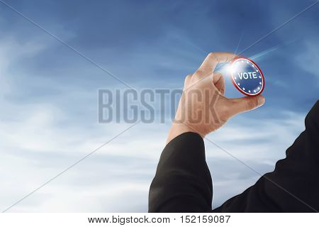 Businessman Hand With A Vote Button