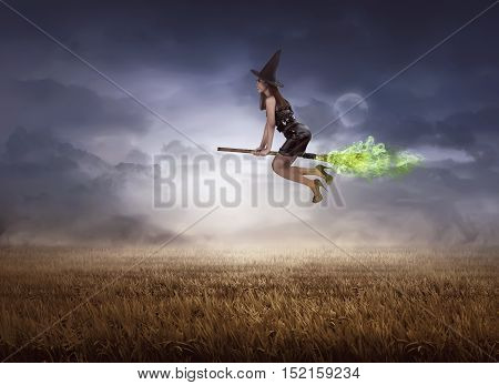 Asian Witch Using Broom Flying