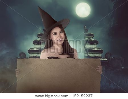 Halloween Asian Witch With Hat Holding Blank Paper