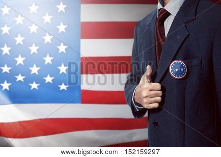 Man With Black Business Suit With Vote Pinned Button Give Thumb Up