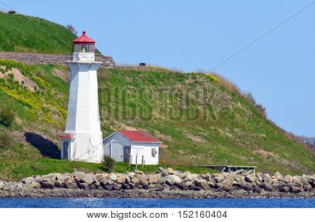 HALIFAX NOVA SCOTIA JUNE 7: Georges Island Lighthouse is a prominent concrete lighthouse, built in 1917 which replaced an earlier tower built in 1876. On june 7 2014 in Halifax Nova Scotia Canada