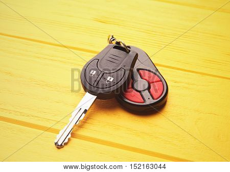 Car key on yellow table