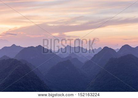 BAC SON, VIETNAM - April 17: Sunrise in mist in Bac Son valley, Lang Son, Vietnam