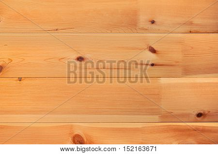 Light brown pine wood plank background. Closeup.