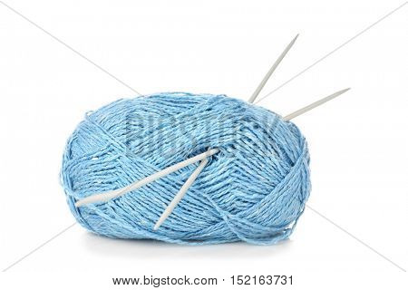 Ball of blue knitting yarn and needles isolated on white