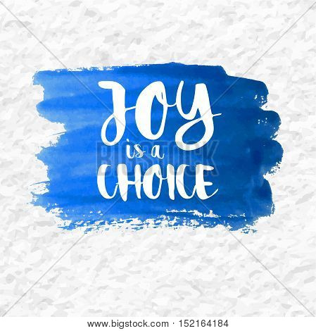 """Joy is a Choice"" quote over a blue watercolor brush wash. Inspirational saying."