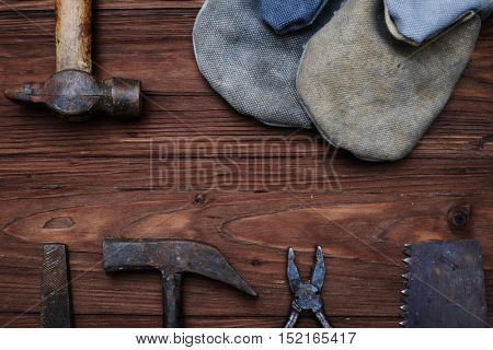 А set of worn tools with a copy space isolated on wooden background