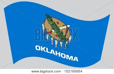 Oklahoman official flag symbol. American patriotic element. USA banner. United States of America background. Flag of the US state of Oklahoma waving on gray background vector
