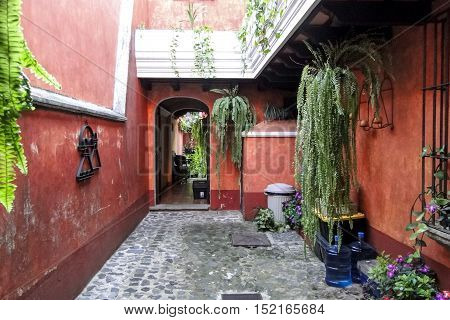 Antigua, Guatemala - June 16, 2011: Garden courtyard with seating and plant life in addition to decor. Editorial use only