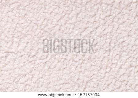 White fluffy background of soft fleecy cloth. Texture of textile closeup.