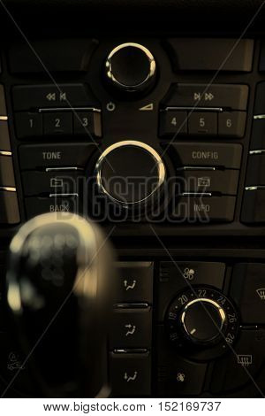 Details closeup of cockpit and dash gearstick in modern car