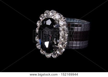 A luxurious tissue holder designed with glass beads and beautiful gemstones on black studio background.