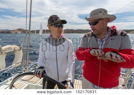MILOS, GREECE - SEP 26, 2016: Sailors participate in sailing regatta 16th Ellada Autumn 2016 among Greek island group in the Aegean Sea, in Cyclades and Saronic Gulf.