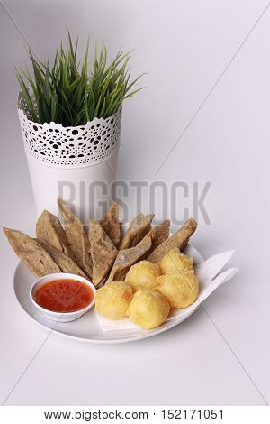 Keropok Lekor Isolated On Wooden Background