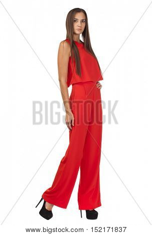 Young beautiful brunette woman in red pantsuit, isolated on white background