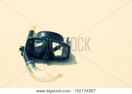 Diving mask and snorkel on sand at phuket thailand beach.