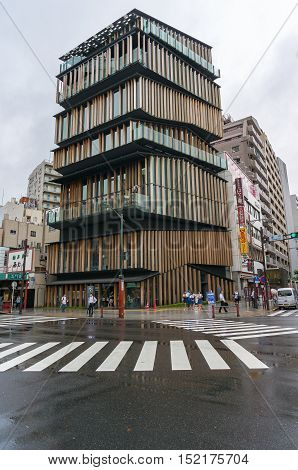 Tokyo Japan - 29 Aug 2016: Asakusa Culture and Tourism Center building on early morning with people on the pedestrian crossing