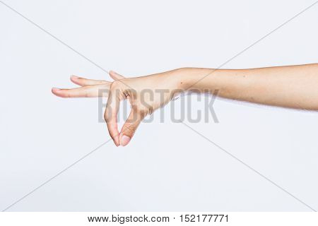 my wife hand in signal of pinch