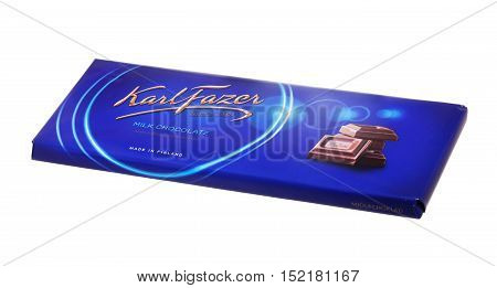 Stockholm, Sweden - November 21, 2013: A blue package with 200 g Karl Fazer milk chocolate bar isolated on white background made in Finland sold on the Swedish market.