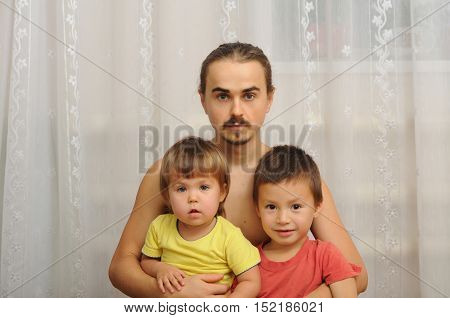 Happy Father With Two Kids
