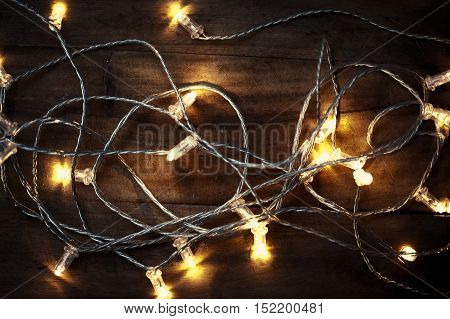 Christmas lights garland on a old wooden floor. Merry Christmas lights